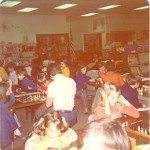Kids playing in a large chess tournament.